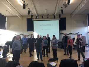 Staff participate in an ice breaker exercise