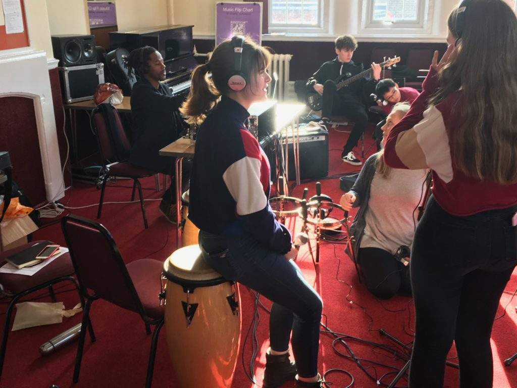 Young people in a music session