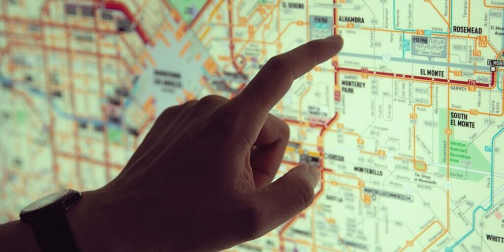 Hand hovering over a map